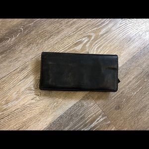 Fossil leather black wallet.